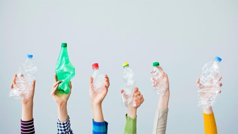 People holding plastic bottles
